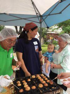 Volunteers cooking octopus balls